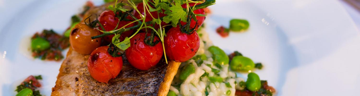 fish with roasted tomatoes and risotto